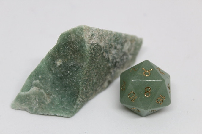 Taurus, an example of the finished dice once carved, engraved, and polished out of Green Aventurine.