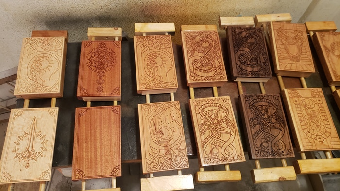 Some of the tomes that will be shipping on Tuesday getting a final coat in the finishing room.