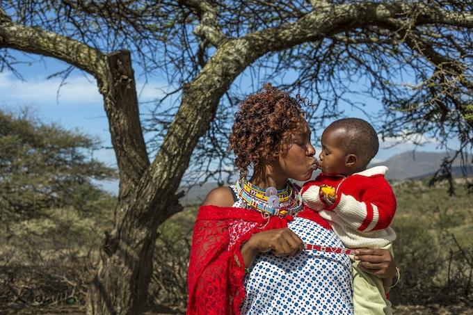 Maasai mother, Ann, kissing her baby.  Photo: Georgina Goodwin