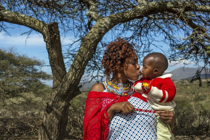 Maasai mother, Ann, kissing her baby.  Photo: Georgina Goodwin