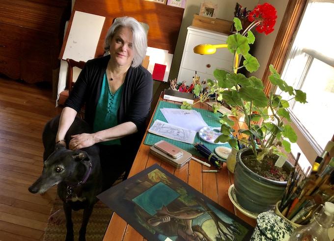 Cover illustrator Etta Moffatt with her rescue greyhound Brooke and Bonny the geranium in her studio