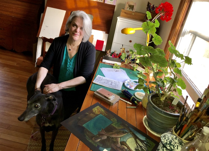Cover illustrator Etta Moffatt with her rescue greyhound Brooke and Bonny the geranium in her studio