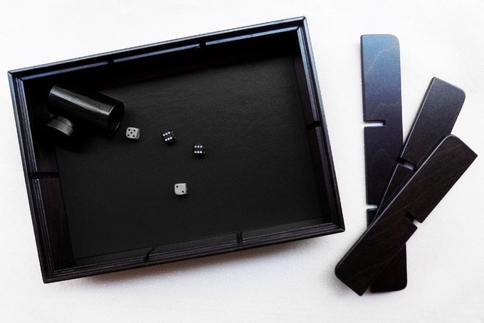 The Master box in brown wood finish and black leather rolling surface.
