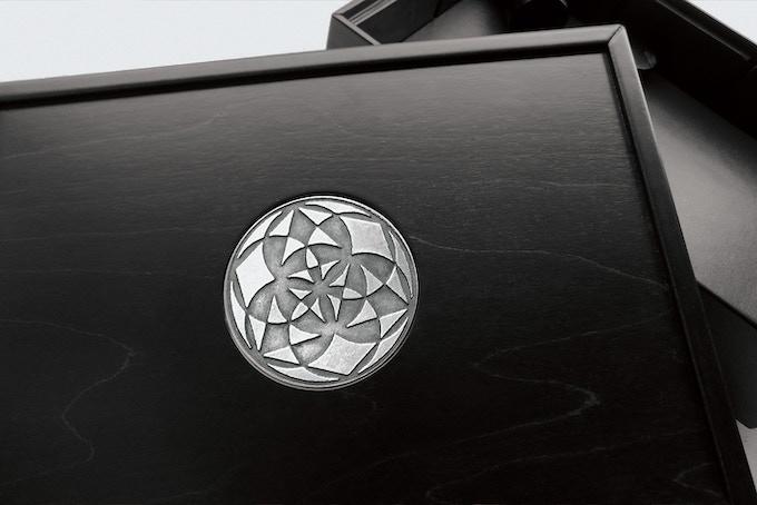 "The Game Master Box. Design: ""Magic Secrets"" in Silver, black wood finish, black leather."