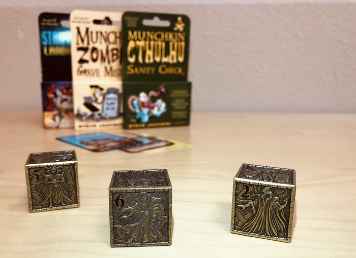 We always have new ideas and new projects. These 25mm metal dice prototypes arrived recently and now all we can ask you is: Who would like to see metal Munchkin dice that follow the same design and manufacturing process as these dice? Click the image to learn more about how we made the dice.