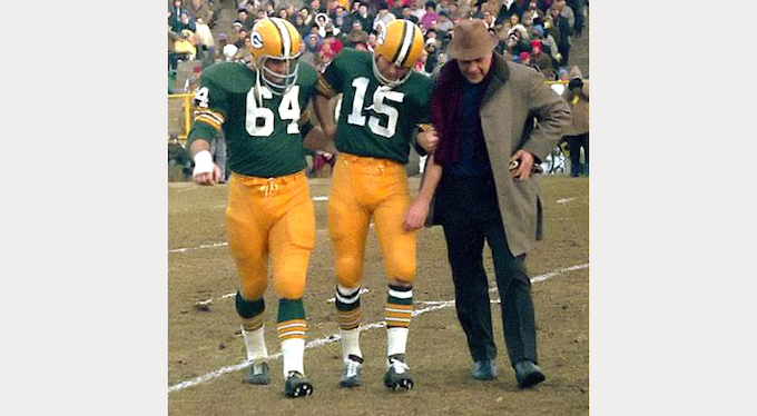 Jerry helps Bart Starr off the field (accompanied by Dr. James Nellen) in the Western Division championship game at Lambeau Field in 1965. Jerry and Bart remained very close. Bart passed, only days before this campaign was launched. It has been determined that a special dedication in this film will be made to Bart Starr.