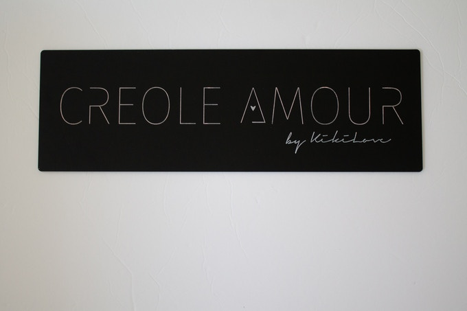 """Custom Logo Sign. This is a 1 layer laser etched acrylic with the letters filled in. This sign is 16"""" W x 5"""" L."""