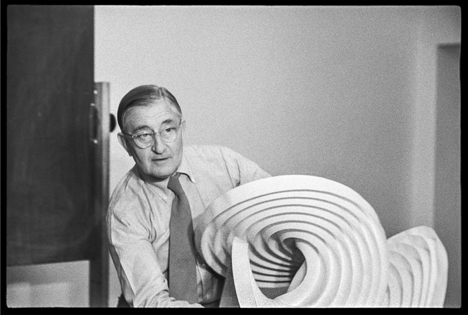 [Silver gelatine portfolio image] Josef Albers with a spatial structure of folded paper in his first preliminary course, January 1954.