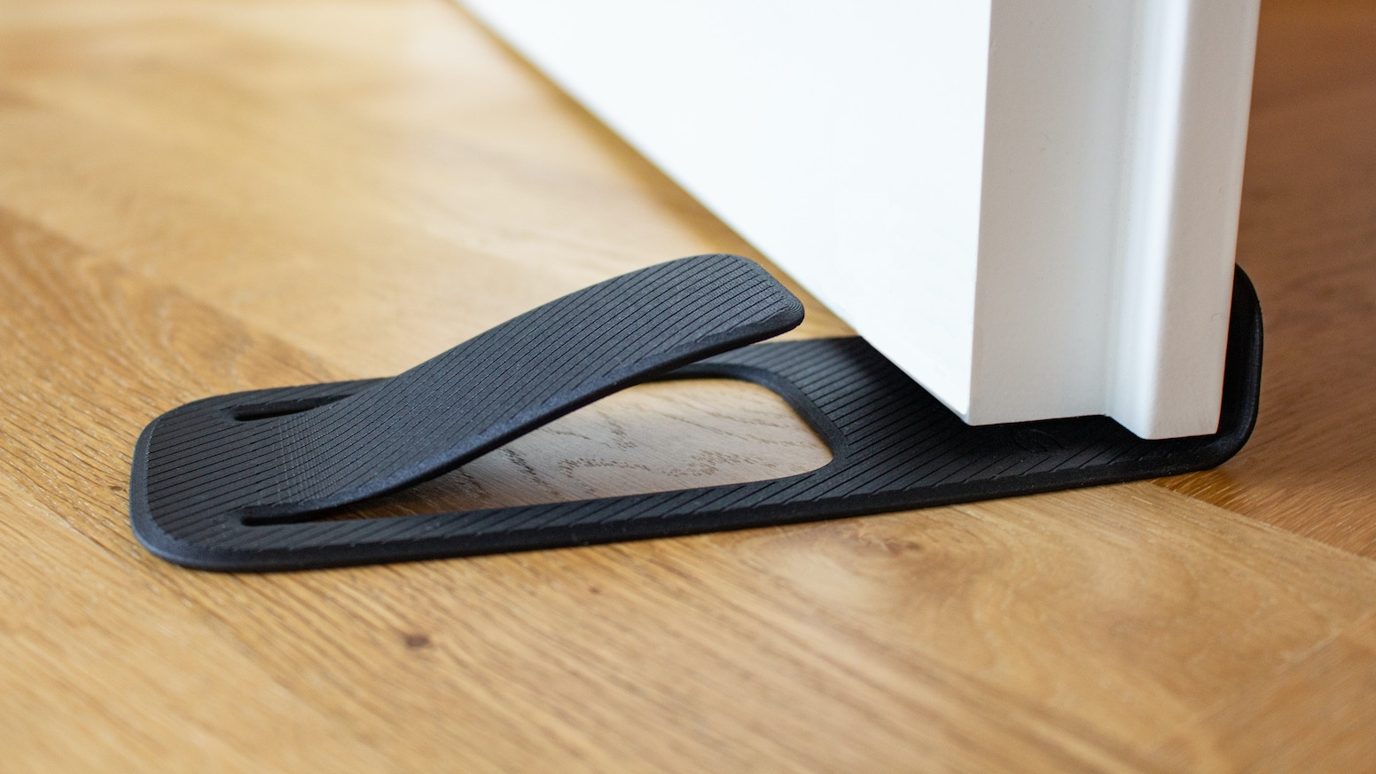 A innovative doorstopper, that holds your door in the most simple and functional way.