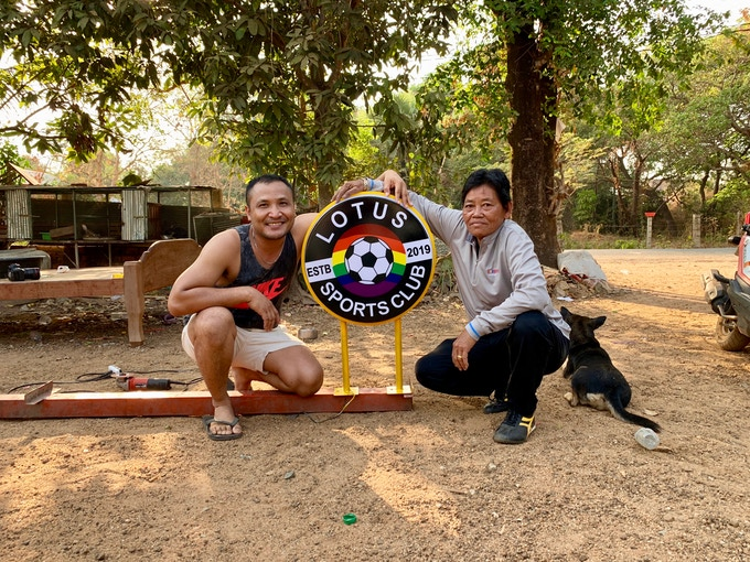 Director Vanna Hem and Sovan posing with the new LSC sign