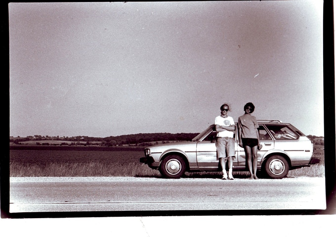 Sebastian and me by the blue Corolla that carried us across country.