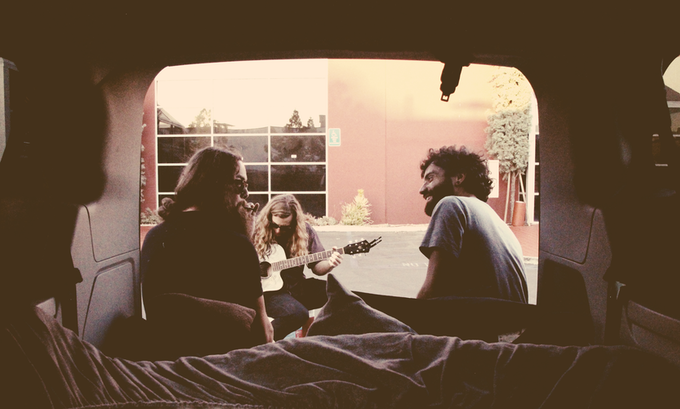 The band in their traveling van, outside their home-brew studio in San Diego, CA