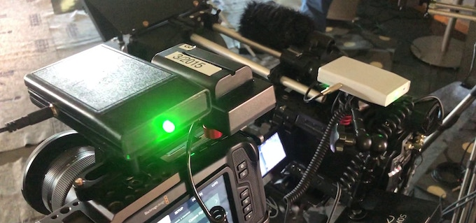 Field testing: v0.2 prototypes syncing Black Magic Pocket 4K and Sony F3 (background, note XLR connector). Photo and testing courtesy of Bill Bennet, ASC.