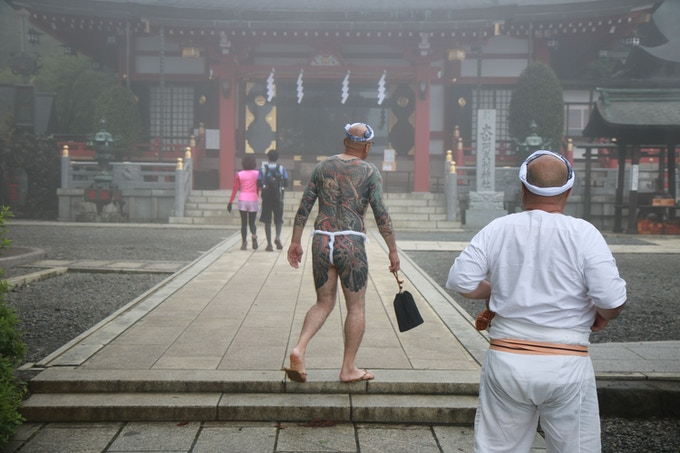 Tattooed pilgrims approach the holy Shinto shrine at Oyama. Photo credit: Alex Reinke and Luca Ortis