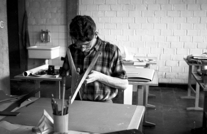 Student Karl Heinz Bergmiller folding paper in Albers' second preliminary course,  15 July, 1955.