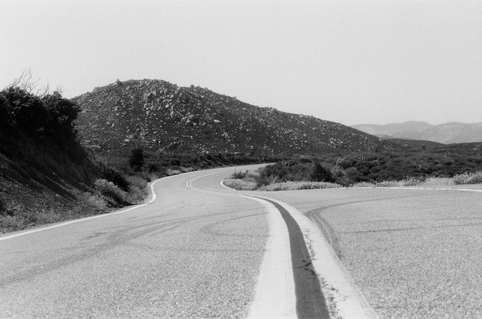Wild Open Roads is a series of selected works from photographer Zachary Spears. Each piece was photographed on traditional black and white 35mm film.