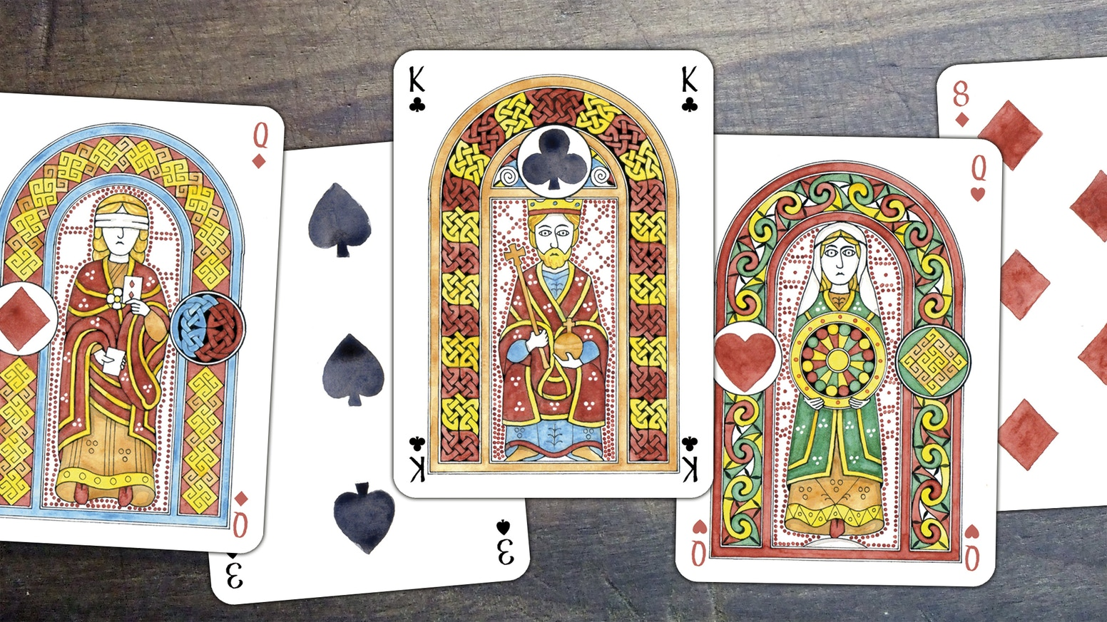 Custom playing cards in the medieval insular art style, illustrated and decorated by Ian Cumpstey