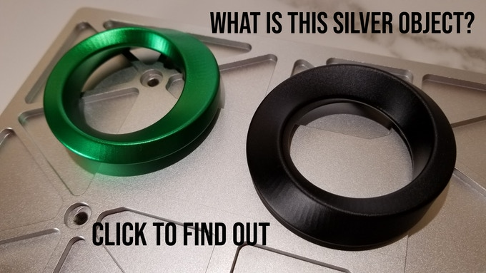 If you want to know what this silver object is the black Möbius is resting on, click the picture to get the launch notification.