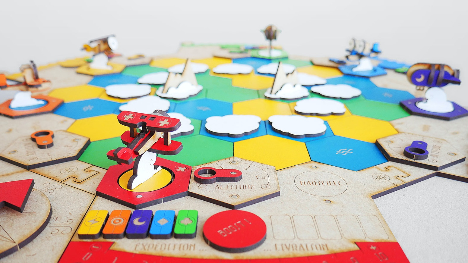 A wooden board game with pickup-and-deliver mechanics. 100% made in France !