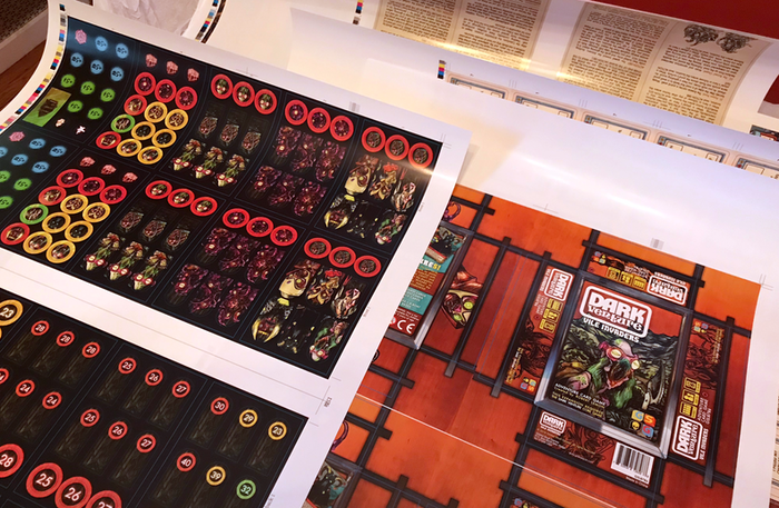 This print shows a double set of token sheets (with tokens and standees). Rich colors!