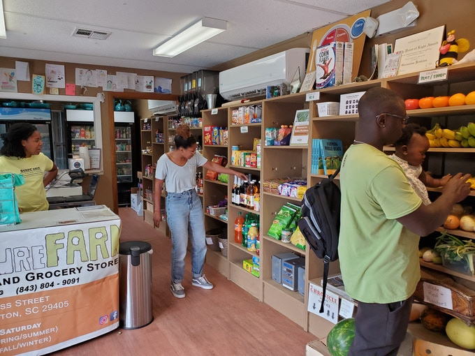 A view inside the farm's upcycled USDA grocery store that boasts sliding scale pricing (inspired by Leah Penniman's book, Farming While Black). The farm's 2018 shelving upgrade came thanks to generous donors (coordinated and installed by Liollio Architecture staff).
