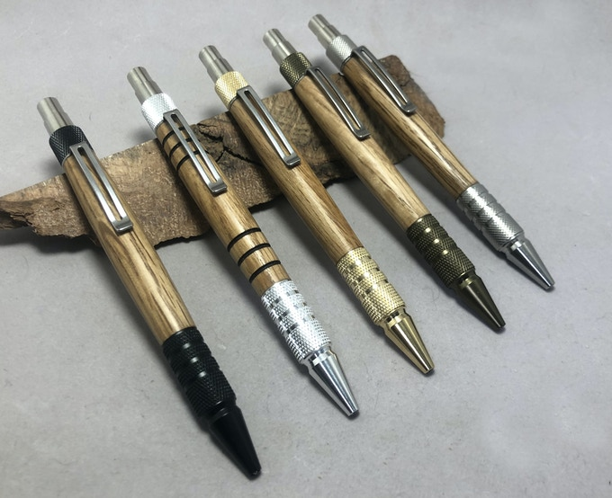 DuraClick pens in Black Aluminum, Aluminum, Brass, Burnt Bronze Aluminum, and Stainless Steel