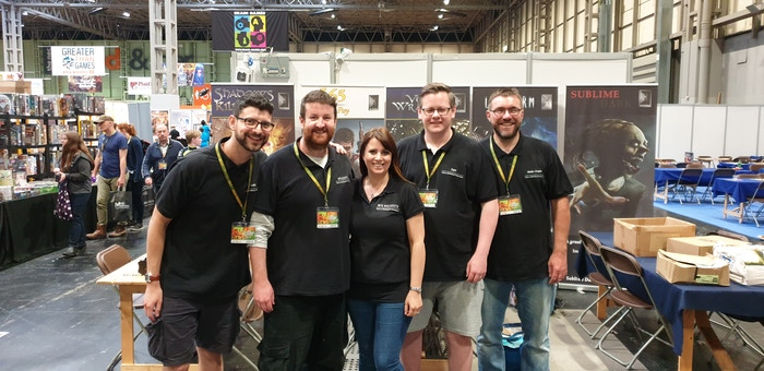 BoardChitless' Leki Williams, Tristan Hall, Francesca Hall, Samwise Gamgee Lawton, and Lifeform designer Mark Chaplin all pitching in to help man the Hall or Nothing stand at UKGE