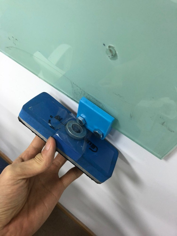 How we knew this was a trustworthy engineering company - they stuck a magnet to their whiteboard duster with tape, and attached a magnetic bolt to their glassboard