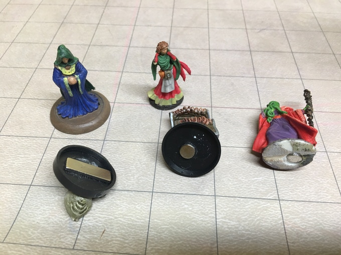 Some methods of adding a magnet. People in this hobby are some of the most creative around, people will undoubtedly come up with many clever ways to attach magnets.