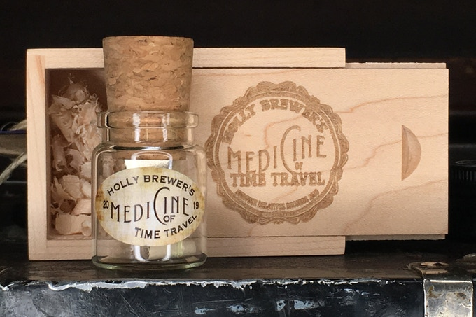 Medicine of Time Travel on a USB cork inside a glass jar nestled in red cedarwood shavings that lives inside a laser etched pine wooden box (magnet closure) Holy prepositions batman!