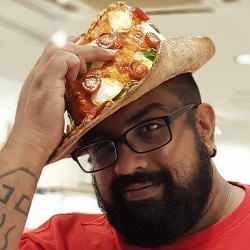 This is Ryan. Yes, he's wearing a pizza hat. It's not real but a friend claims to have seen him lick it.