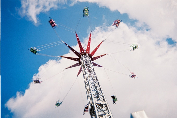 """Funride, Ealing Common, by Lui Saatchi. Top 20 photo (not in 2020 calendar). Lui wanted to take a picture of the funfair ride when went up, """"so I stayed there a few minutes. When it went up I just lay on the ground because I couldn't get all the image inside the frame so I was on the floor. People were looking at me trying to figure out what I was doing there!"""" Lui goes to the 240 Project art group."""