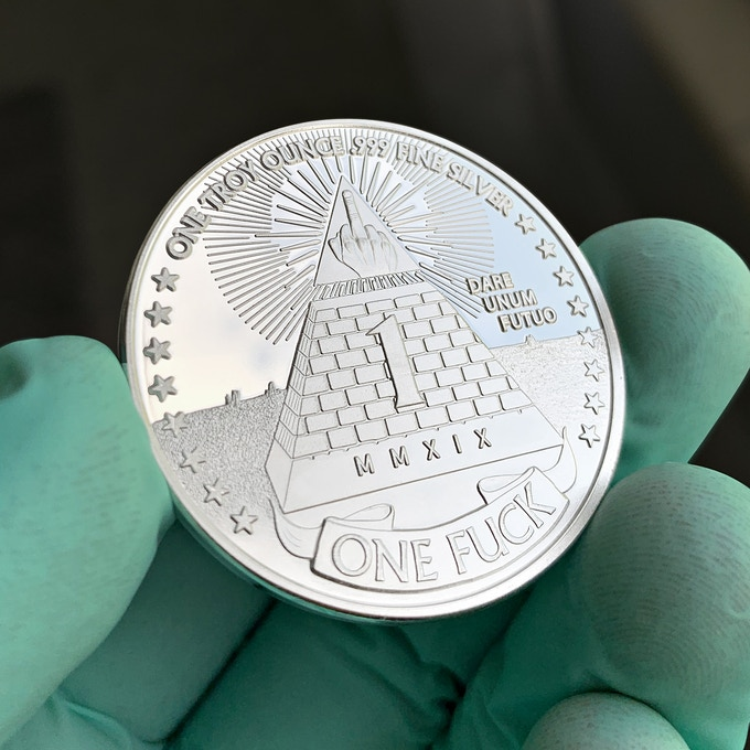 """""""One Troy Ounce .99 Fine Silver"""" is minted on the """"One Fuck"""" side of each silver coin"""