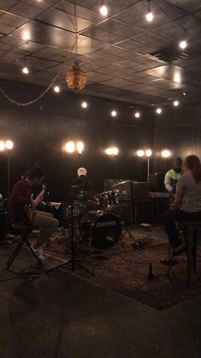 The band getting ready for recording.