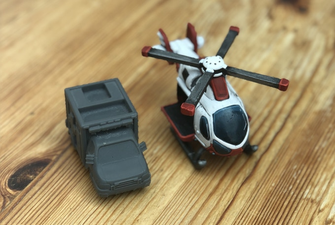 A painted version of the initial design of the helicopter mini vs the 3D ambulance