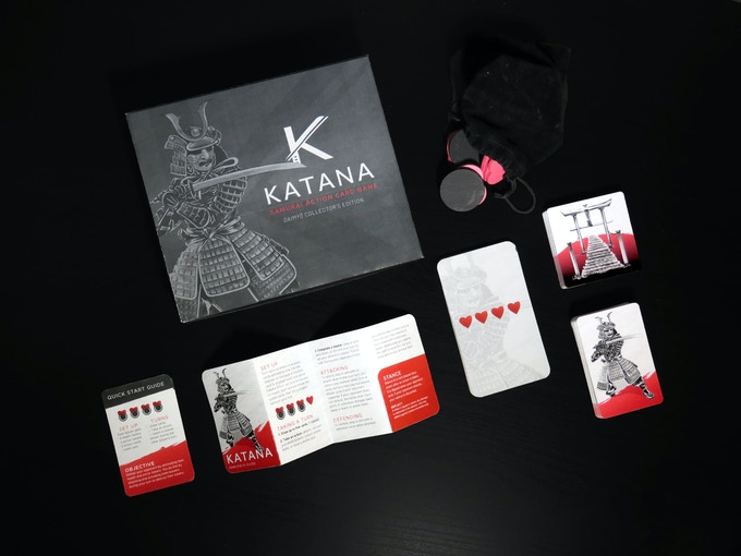Katana—Daimyō Edition XL includes: an Action deck (50 cards), Kami deck (12 cards), Shrine deck (24 cards), 10 Health tokens, 12 Armor tokens, Samurai's Guide, Quick Start Guide, Collector's box