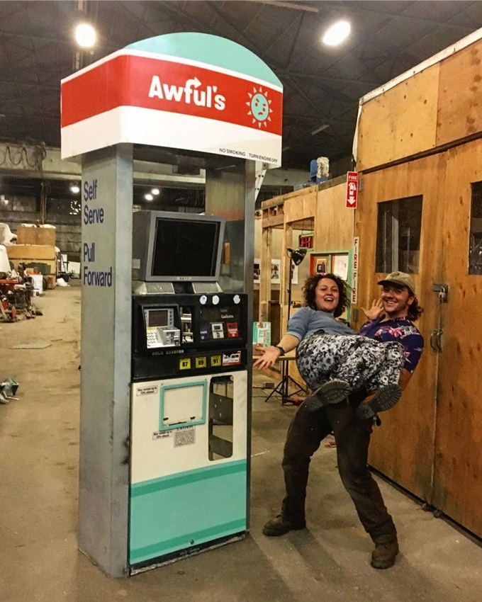 Our assembled gas pump, along with curators  Madeline Fried (flyer) and Matthew Gerring (base)