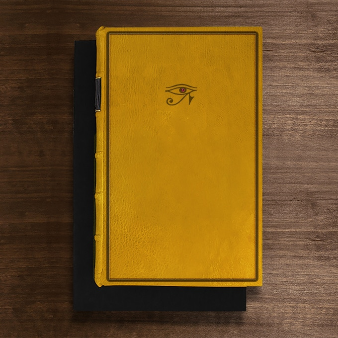 The Horus Edition: Bound in Yellow Full-Leather with hand-marbled end papers. Hand tooled in genuine gold. Set with a cabochon ruby.Presented in a suede lined clamshell box. Only 1 available.