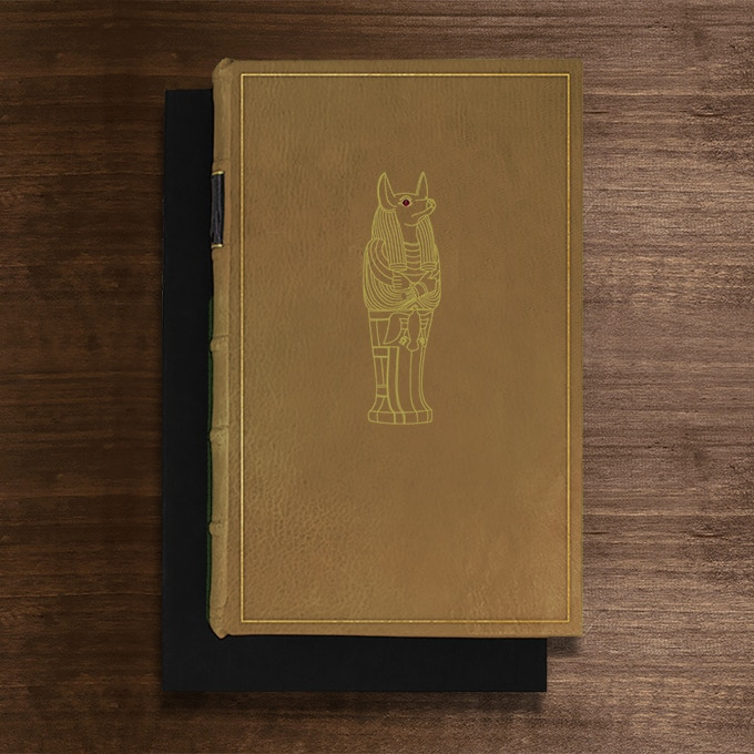 The Anubis Edition: Bound in Sand Full-Leather with hand-marbled end papers. Hand tooled in genuine gold. Set with a genuine cabochon garnet. Presented in a suede lined clamshell box. Comes with Millennial Cities photogravure portfolio. Only 3 sets available.