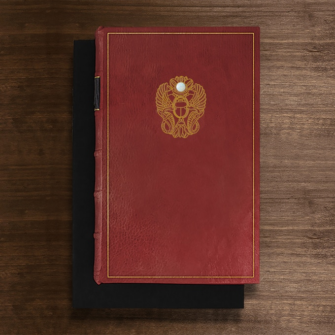 THE PRIZE BOOK will be awarded to the first person who answers all of the questions correctly. The Prize Book is bound in Scarlet full leather. It features hand-marbled end papers and is hand tooled in genuine gold. It is set with an opal cabochon and is presented in a suede lined clamshell box.  Only one copy will ever exist.