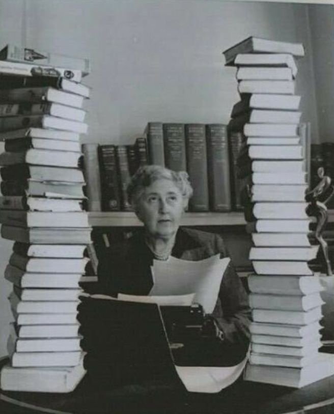 This unique, one of a kind volume includes this portrait of Agatha Christie among her books and...