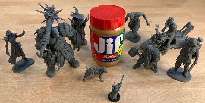 Peanut butter and Warhammer mini (bottom center) for scale. These are prototype resin 3D prints made at low resolution to test scale. The final product will have better detail and color.