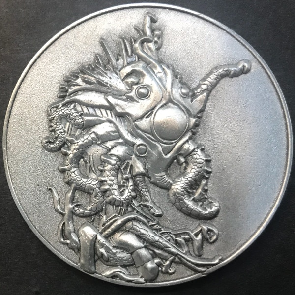 Front of Daemon Sultan coin - plated in antique silver