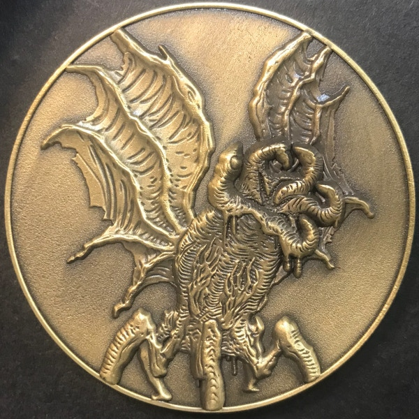 Front of Elder Thing coin - plated in antique gold