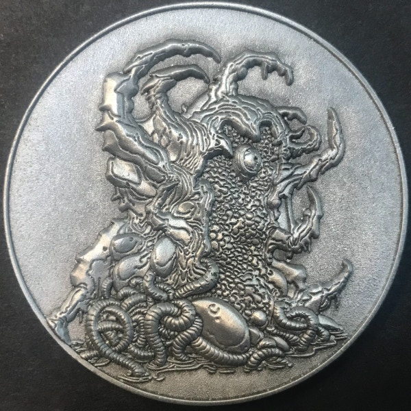 Front of Ghatanothoa coin - plated in antique silver