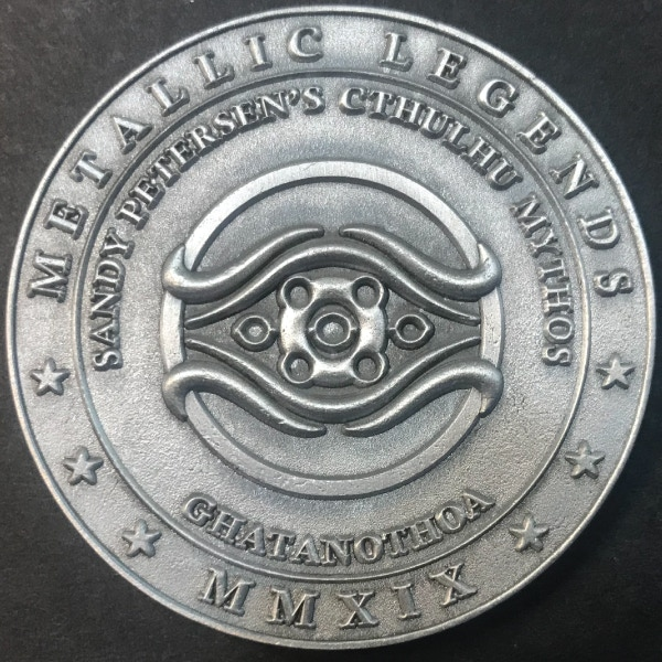 Back of Ghatanothoa coin - plated in antique silver
