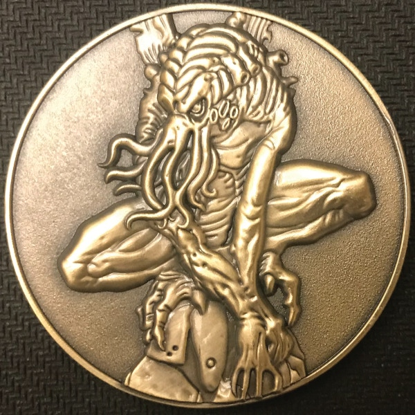 Front of Cthulhu coin - plated in antique gold