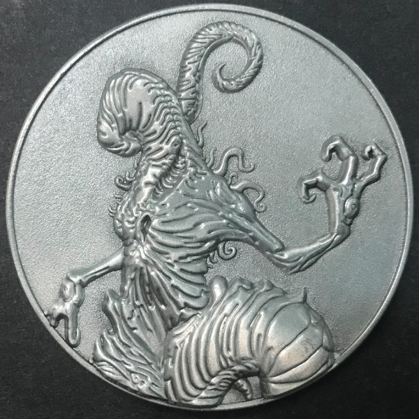 Front of Crawling Chaos coin - plated in antique silver