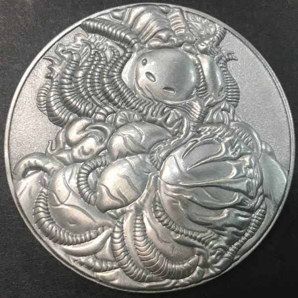Front of Opener of the Way coin - plated in antique silver