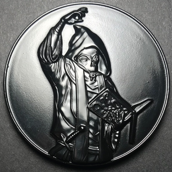 Front of the Cultist coin - plated in black metal